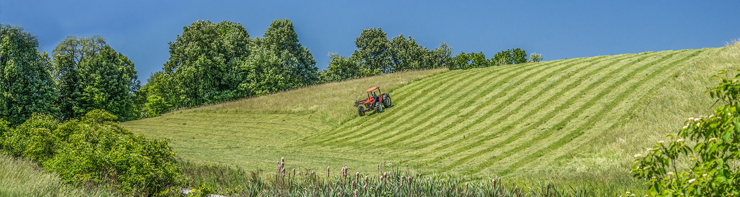 Tractor mowing field in Clinton, NY