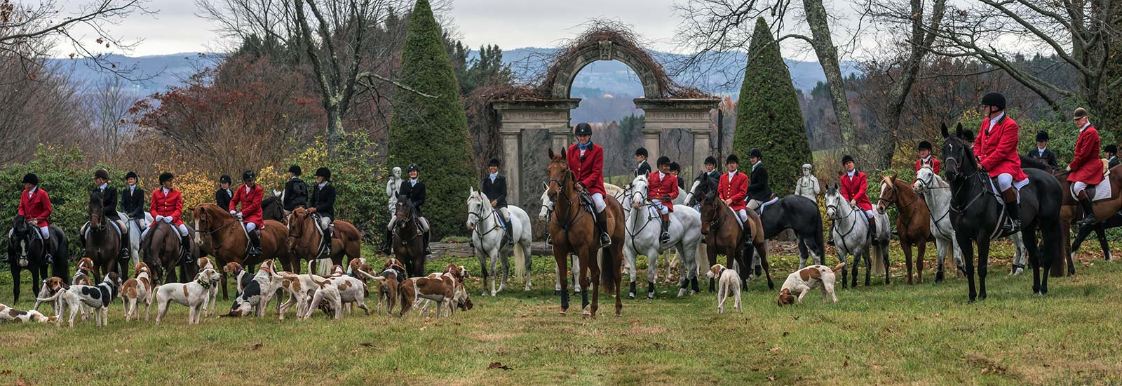 Hunters on horseback with dogs at Millbrook Hunt